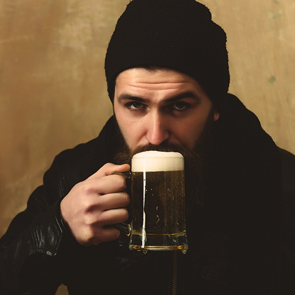 Frothy guy drinking beer copy