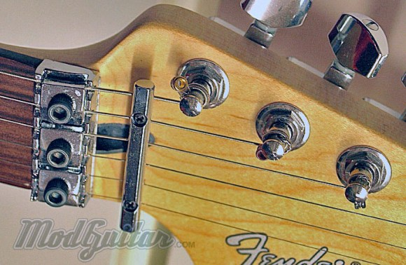 Floyd Rose equipped guitar with standard tuners, but a locking nut & tremolo.