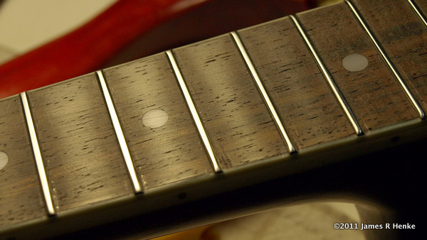 The Fretboard cleaned after filing and sanding.
