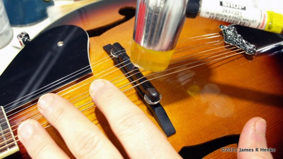 Tapping grooves in the leveled bridge.