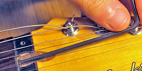 Attempting to make an adjustment to the stripped truss rod socket with a 1/8
