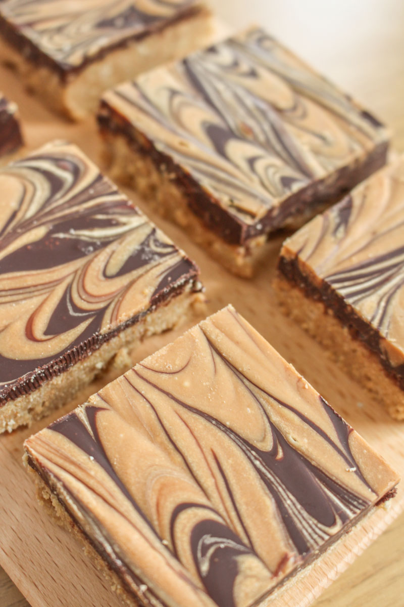 Chocolate & Peanut Butter Bars - a peanut butter biscuit base, smothered with a dark chocolate and peanut butter topping.