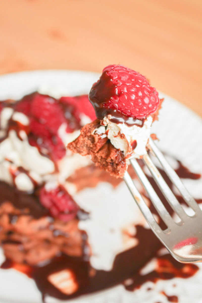 Chocolate Waffles, drizzled with chocolate sauce and topped with fresh raspberries and whipped cream | What Charlotte Baked