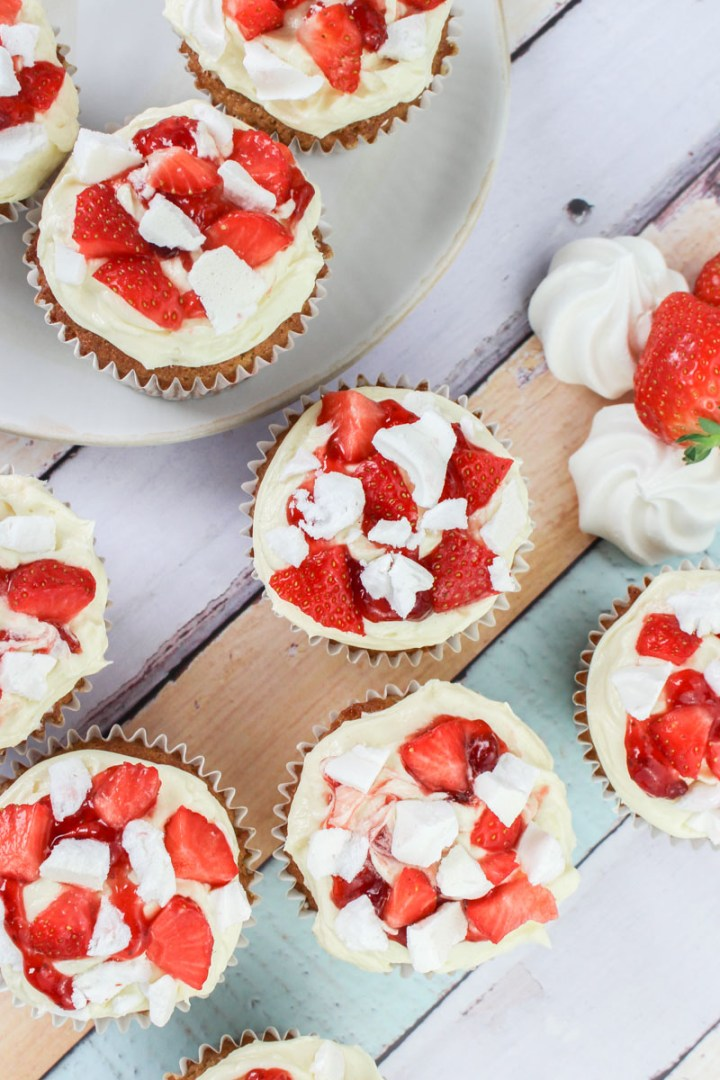 Eton Mess Cupcakes recipe - Strawberry cupcakes filled with strawberry jam and topped with buttercream, fresh strawberries, and meringue pieces | What Charlotte Baked
