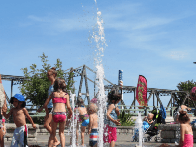 Kids playing in the fountain at Centennial Riverwalk Park in 90-degree weather (August 19, 2016). Photo: Whatcom News