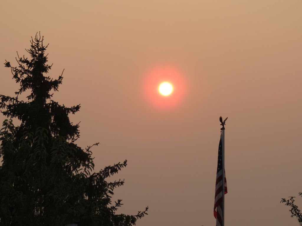 red sunrise due to smoke from bc wildfires with no air movement 2017-08-02