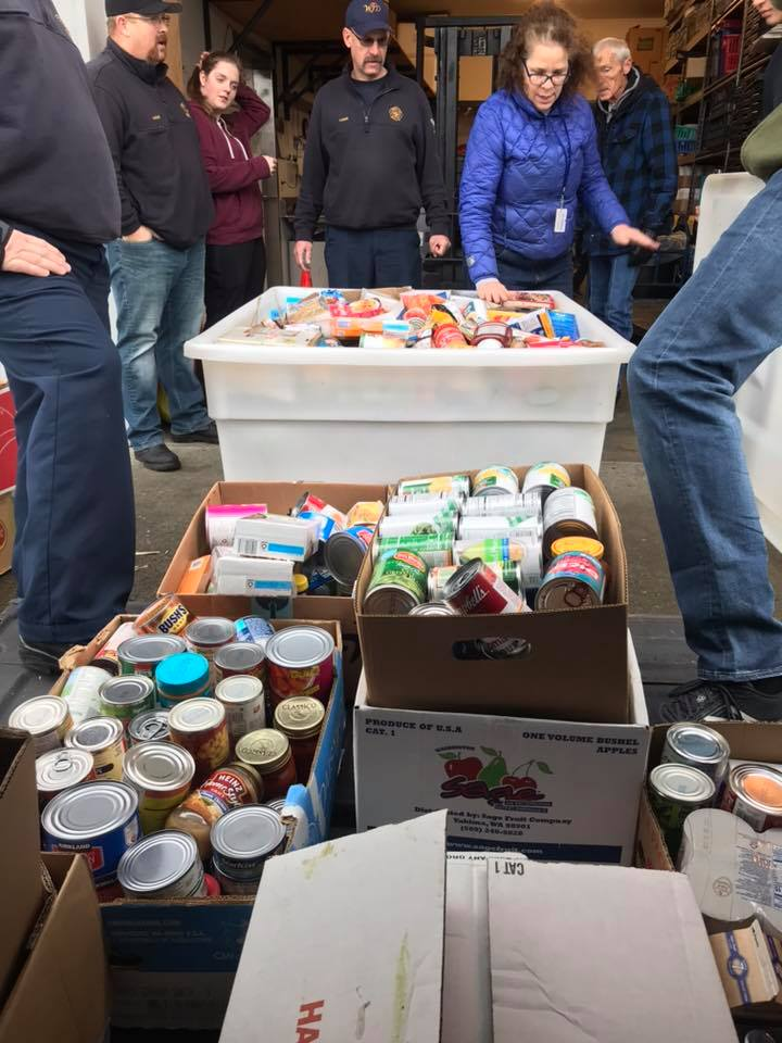 whatcom 7 firefighters drop off 2018 santa drive donations at food bank
