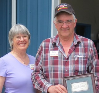 Pete, Jr. and Nita Harksell pose with one of the NAPA/ASE awards they have received while running Pete's Auto Repair (June 27, 2017). Photo: Whatcom News