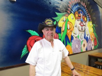 Manuel Reta, owner of Don Samuel's Mexican Grill & Tequila Bar, poses in front of a mural recently completed in time for the restaurant's grand opening (January 2, 2019). Photo: My Ferndale News