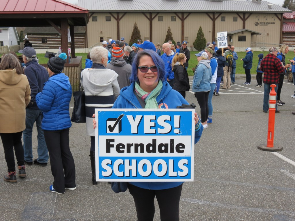 Ferndale School bond proposal supporter Poem Pitzer poses with her sign during a rally at Pioneer Park (January 26, 2019). Photo: My Ferndale News
