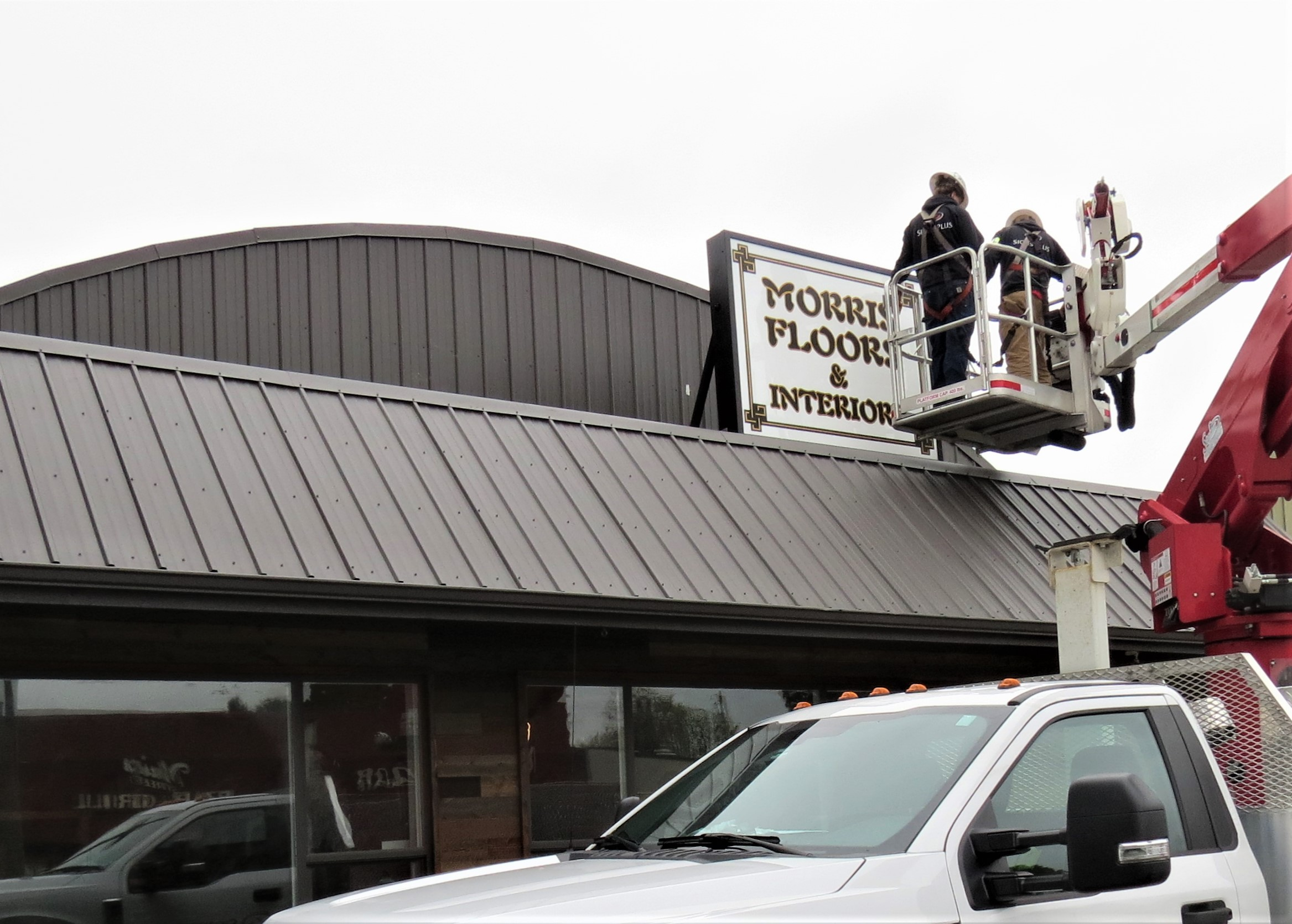 The Morris Floors & Interiors sign gets put in place at the company's new Ferndale location at 2002 Main Street (April 19, 2019). Photo: My Ferndale News