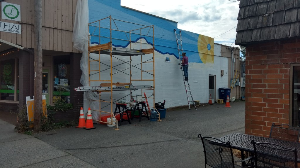 Brenda Goddard-Laurence at work on a mural in an alley on 3rd Avenue in Ferndale (June 12, 2019). Photo: My Ferndale News