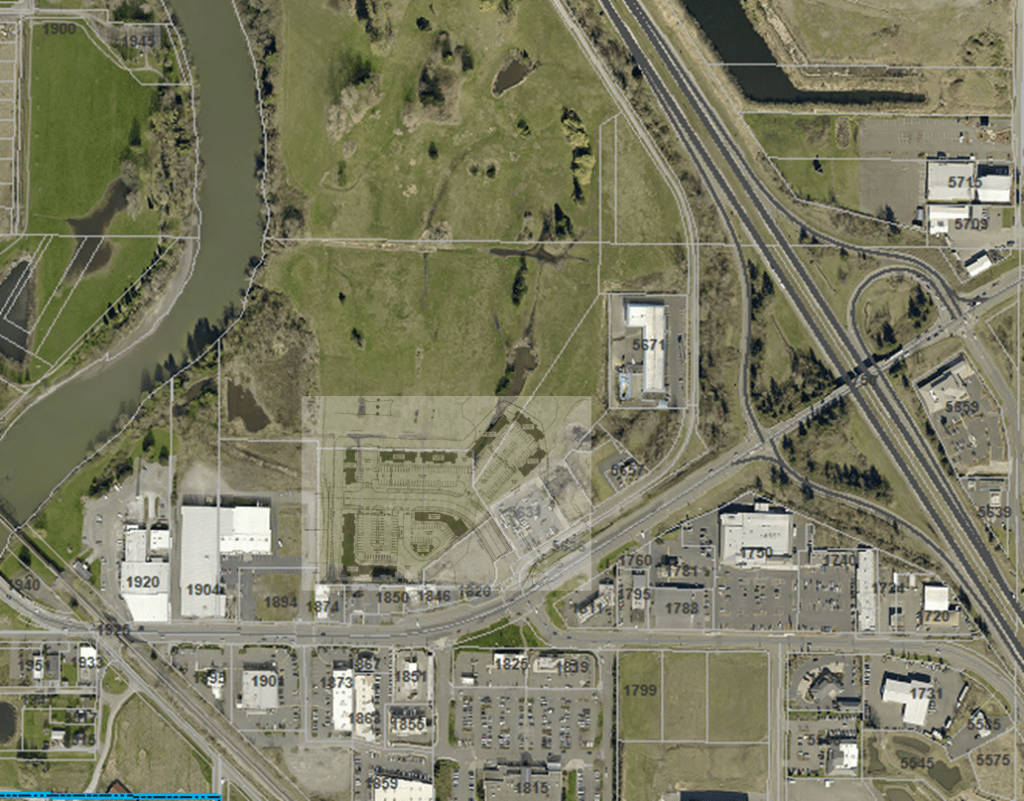Riverside Place initial site plan superimposed over a satellite image.
