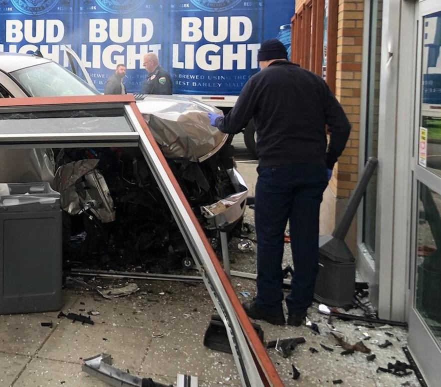 Scene of a 1-car vs building crash at 260 Tobacco & Fine Spirits on Rural Avenue (December 10, 2019). Photo courtesy WCFD7