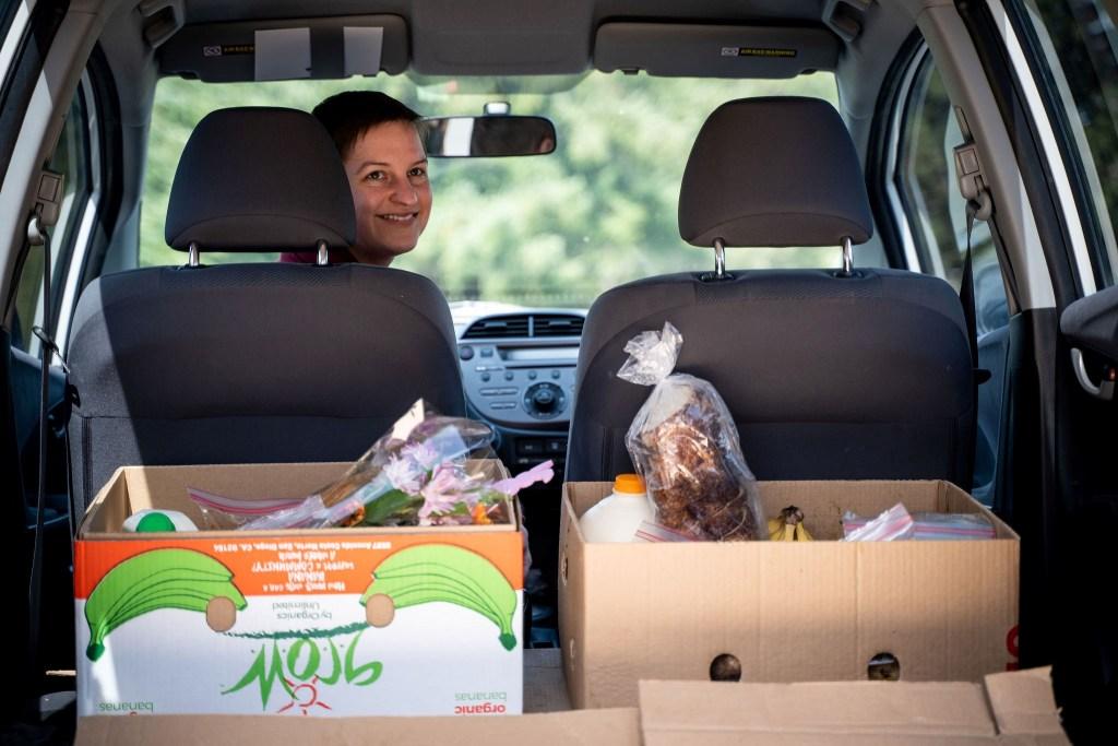 Miracle Food Network Volunteer Driver Amanda prepares to deliver food (April 13, 2020). Photo: Alex Bodi Hallett of Sattva Photo