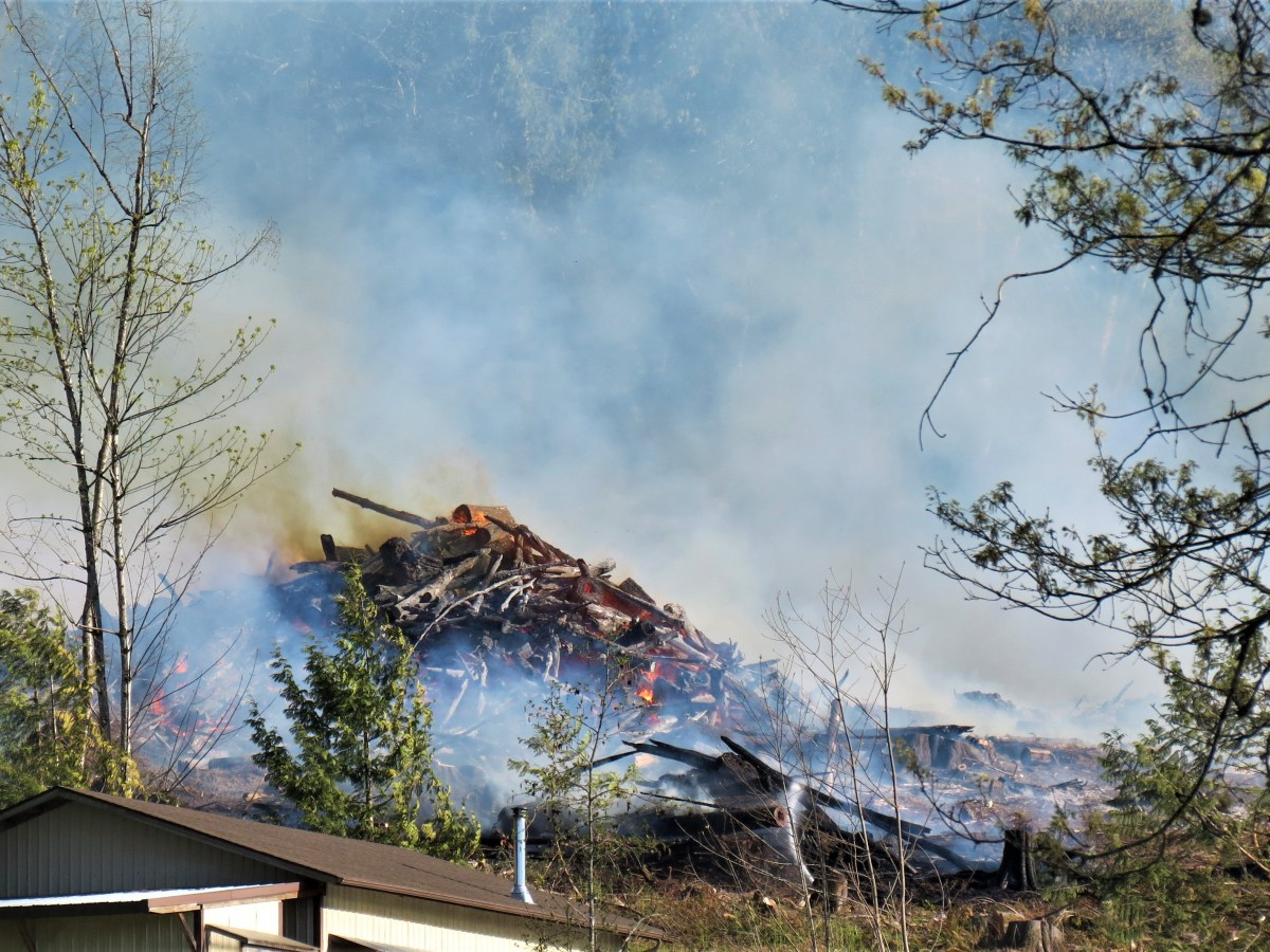 Scene of an outside fire in the 3100 block of Mt Baker Highway (April 18, 2021). Photo: Whatcom News