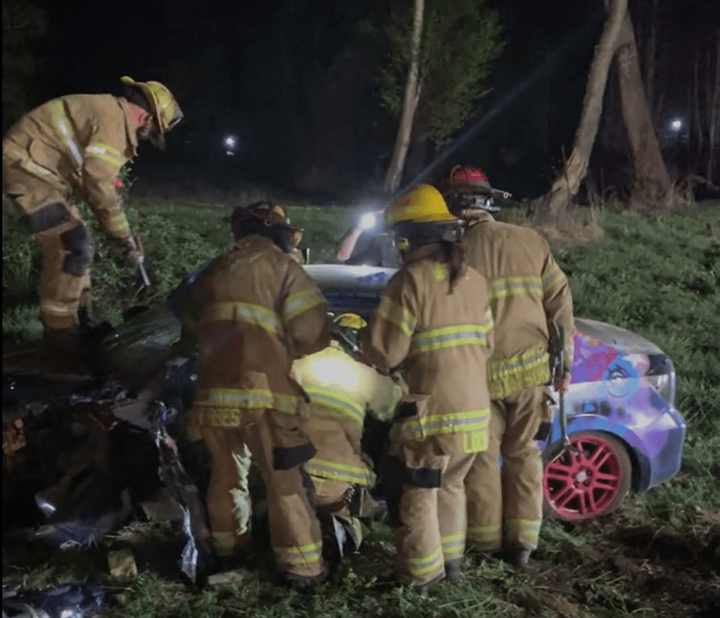 Firefighters work to extricate the driver in a single-vehicle crash (April 23, 2021). Video courtesy of WCFD7.