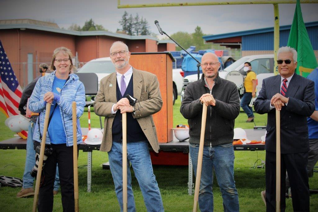 Ferndale City Councilmember Erin Gunter, Mayor Greg Hansen and City Councilmembers Paul Shuey and Herb Porter pose during the new FHS building groundbreaking ceremony (April 27, 2021). Photo: Tanya Shuey - courtesy of Ferndale School District