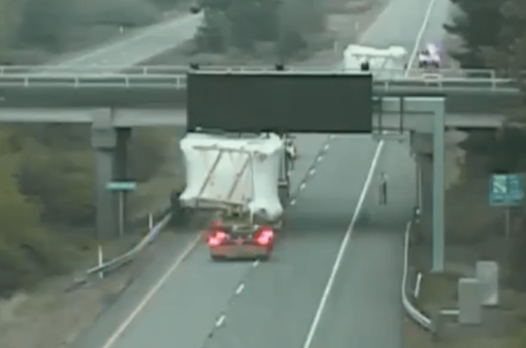 """A """"super load"""" is seen on a WSDOT camera blocking the northbound lanes of I-5 while unable to pass under the Loomis Trail Road overpass (May 5, 2021)."""