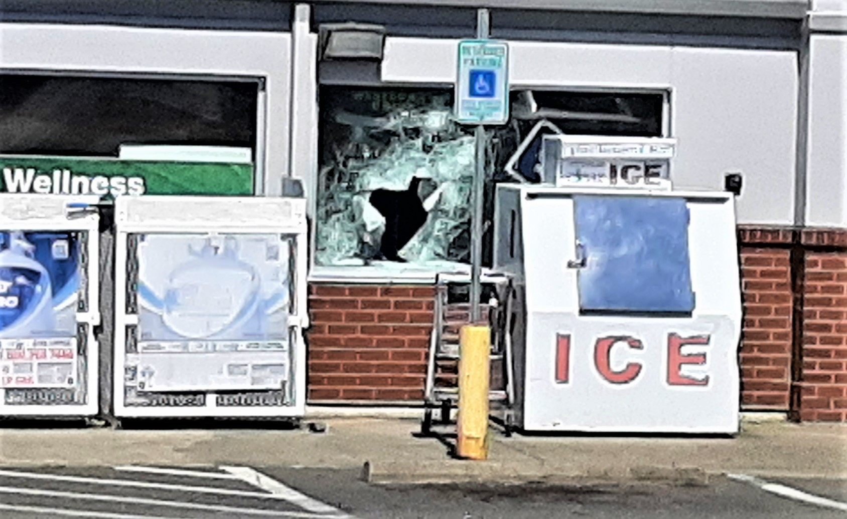 A hole used by burglars is visible in a window at a business on 3rd Avenue in Ferndale (June 25, 2021). Photo courtesy of a reader