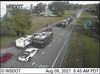 Vehicles line up to cross the Peace Arch border crossing into Canada from the US when the border was reopened to non-essential travel after a 17-month closure (August 9. 2021). Source: WSDOT