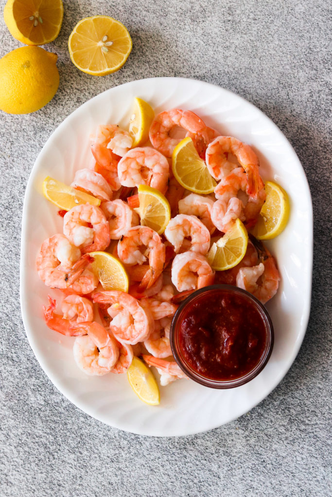 Instant pot shrimp cocktail finished and peeled on a plate