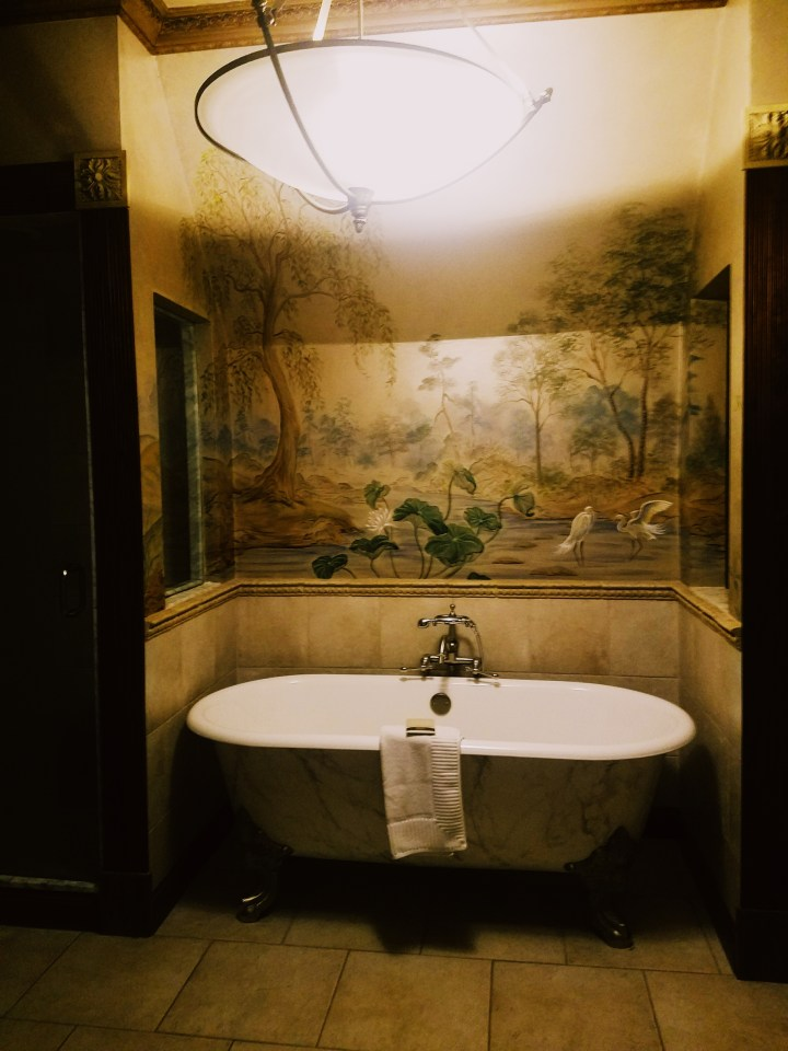 1920's detailed bathroom with clawfoot tub at Oheka Castle on Long Island