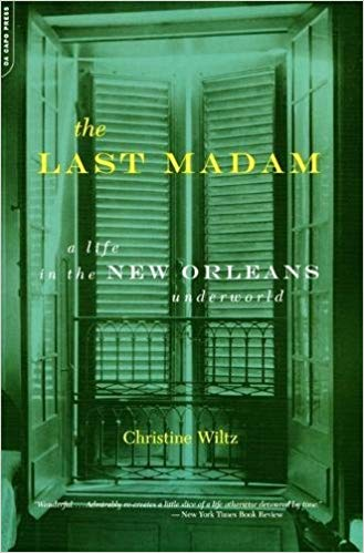 "The front cover of the novel, ""The Last Madam."" It is a green cover with yellow and white writing."