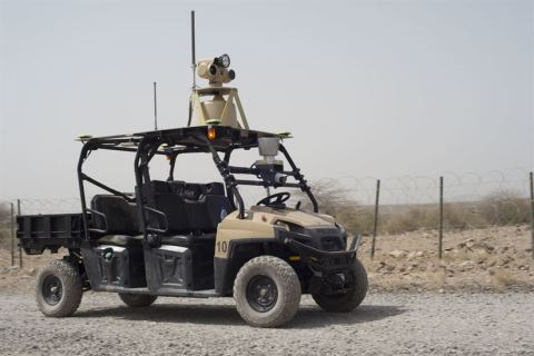 A mobile detection assessment response system patrols the perimeter of an airfield in Djibouti