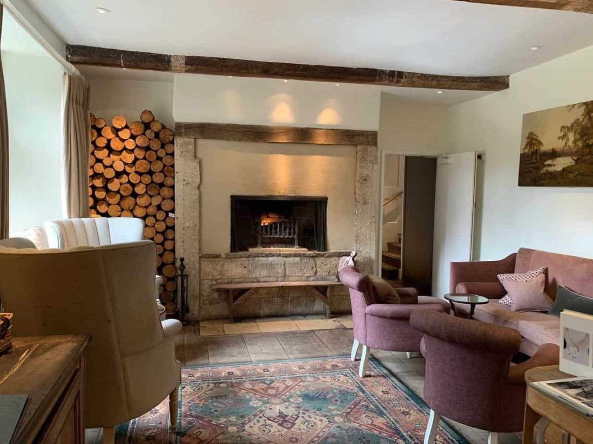 Fireplace in the lounge at Barnsley House