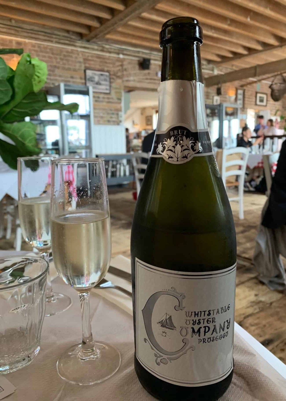 Bottle of branded Prosecco at Whitstable Oyster Company