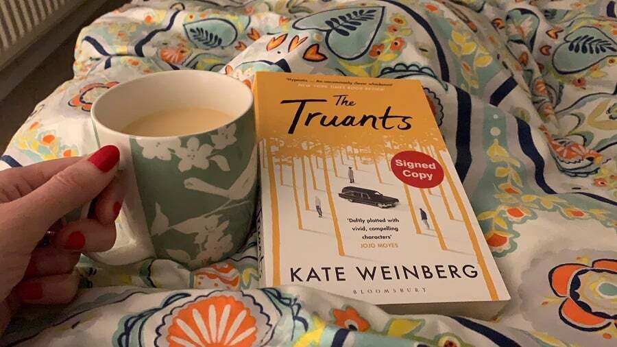 Reading in bed with a cup of tea