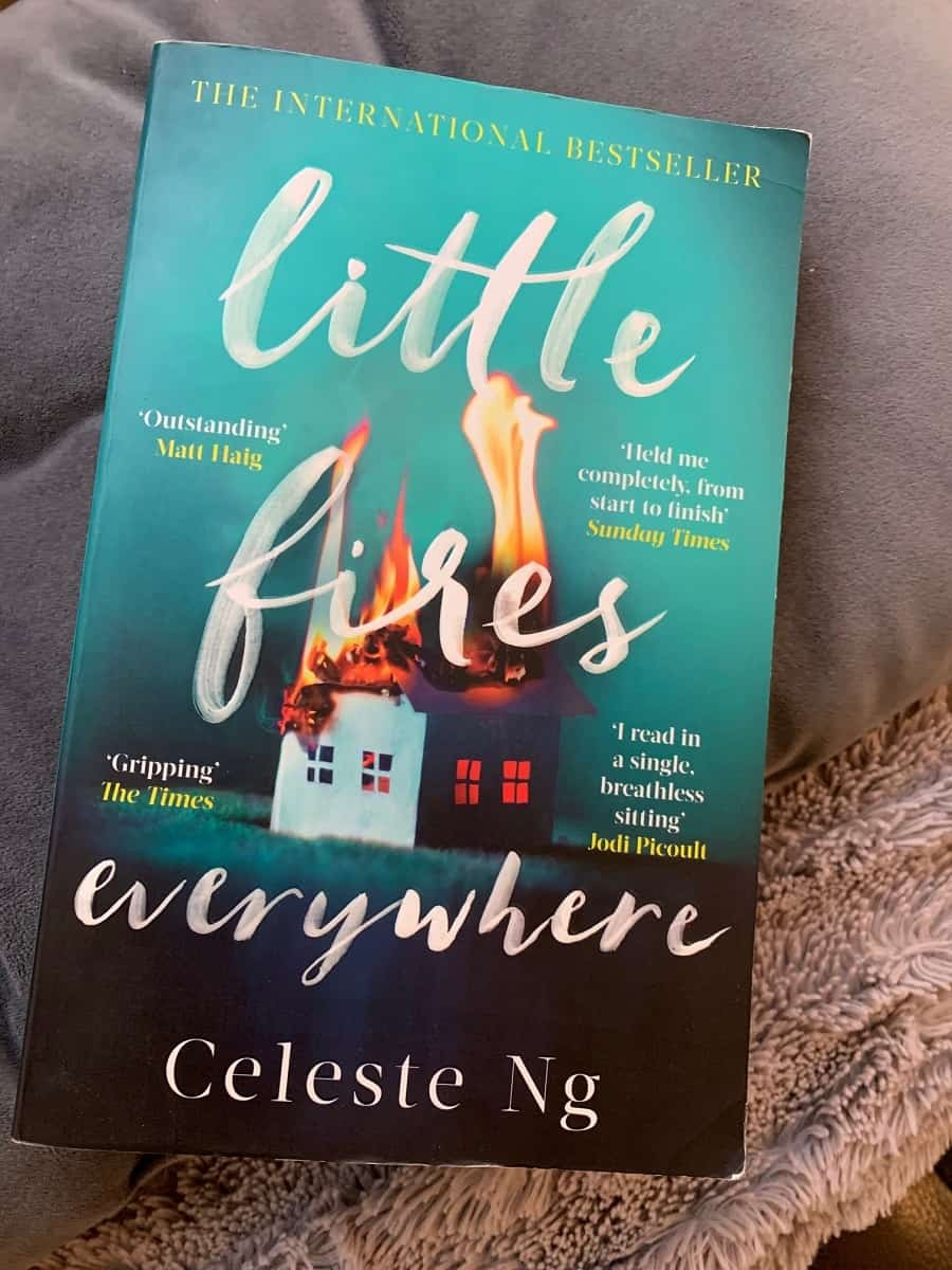 Little fires everywhere novel on a grey blanket