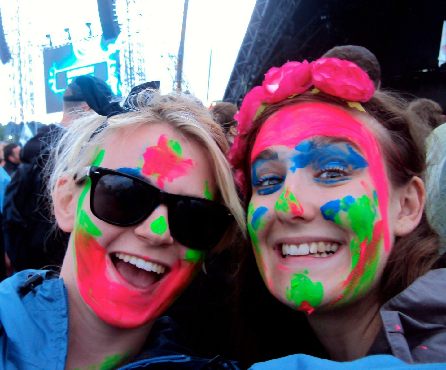 Girls with face paints in the crowd