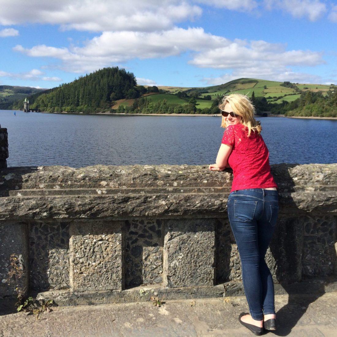 Laura on the bridge overlooking the lake