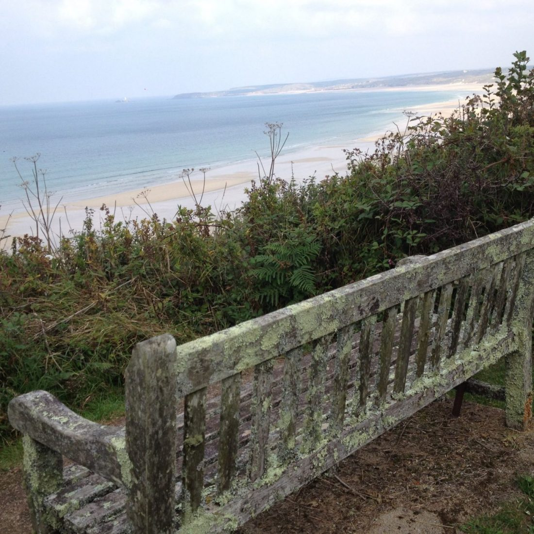 Bench with a view of Porthkidney Beach, Cornwall