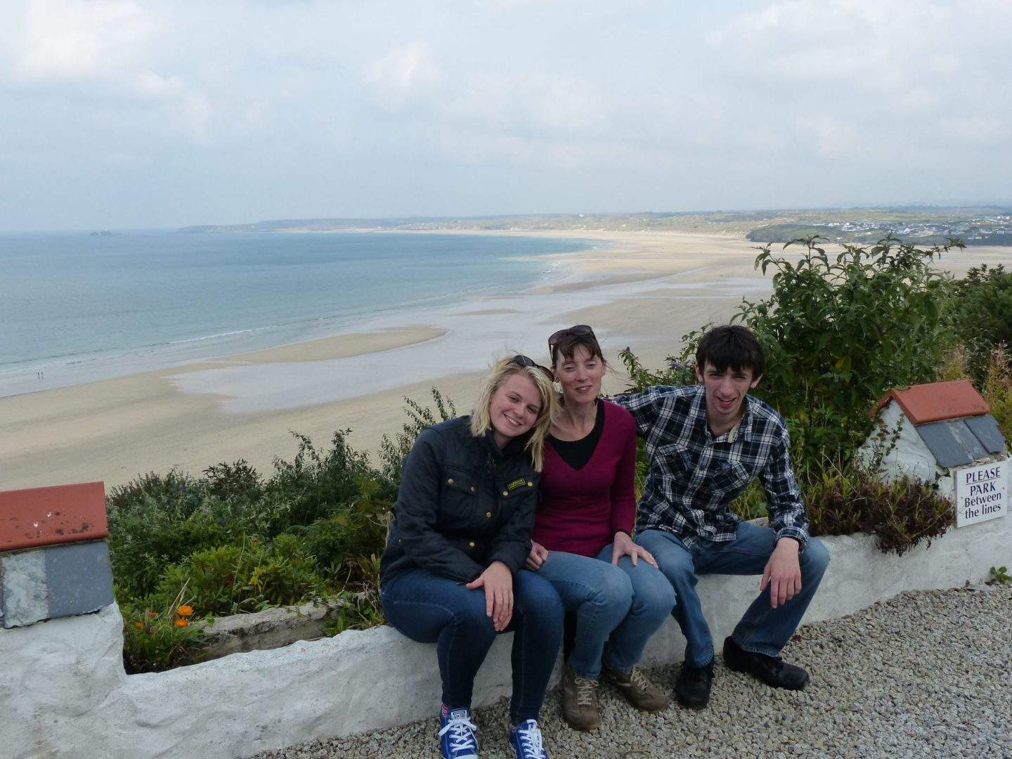 Family overlooking Porthkidney Beach, Cornwall
