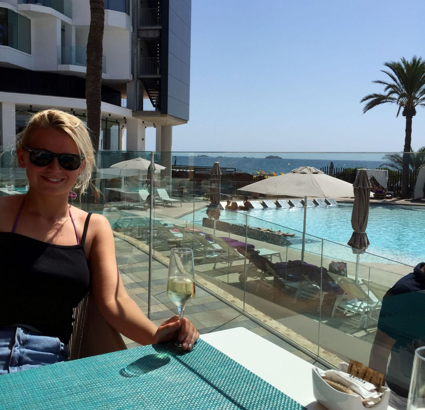Laura at the pool in Ibiza