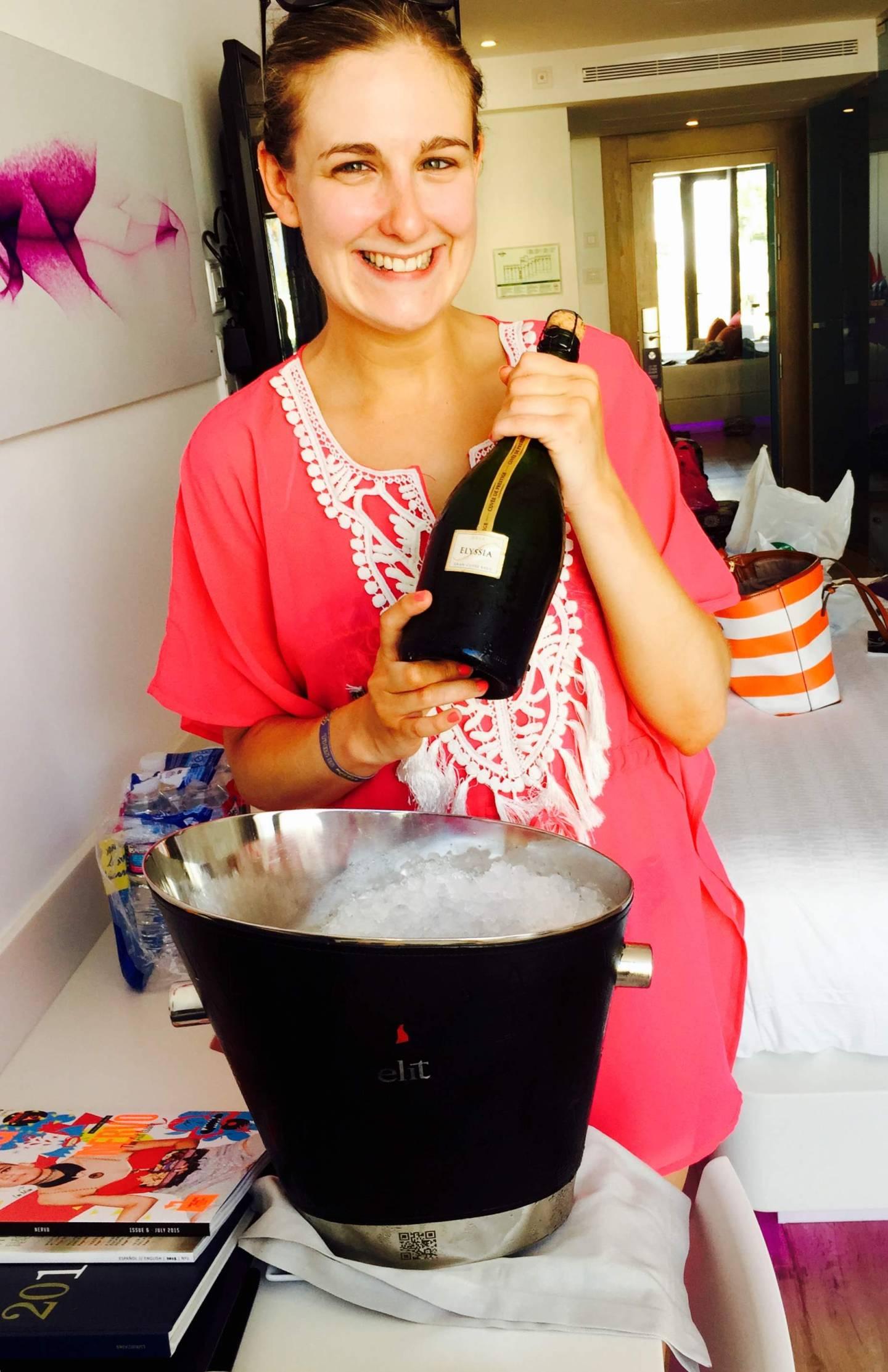 Jo celebrating with champagne