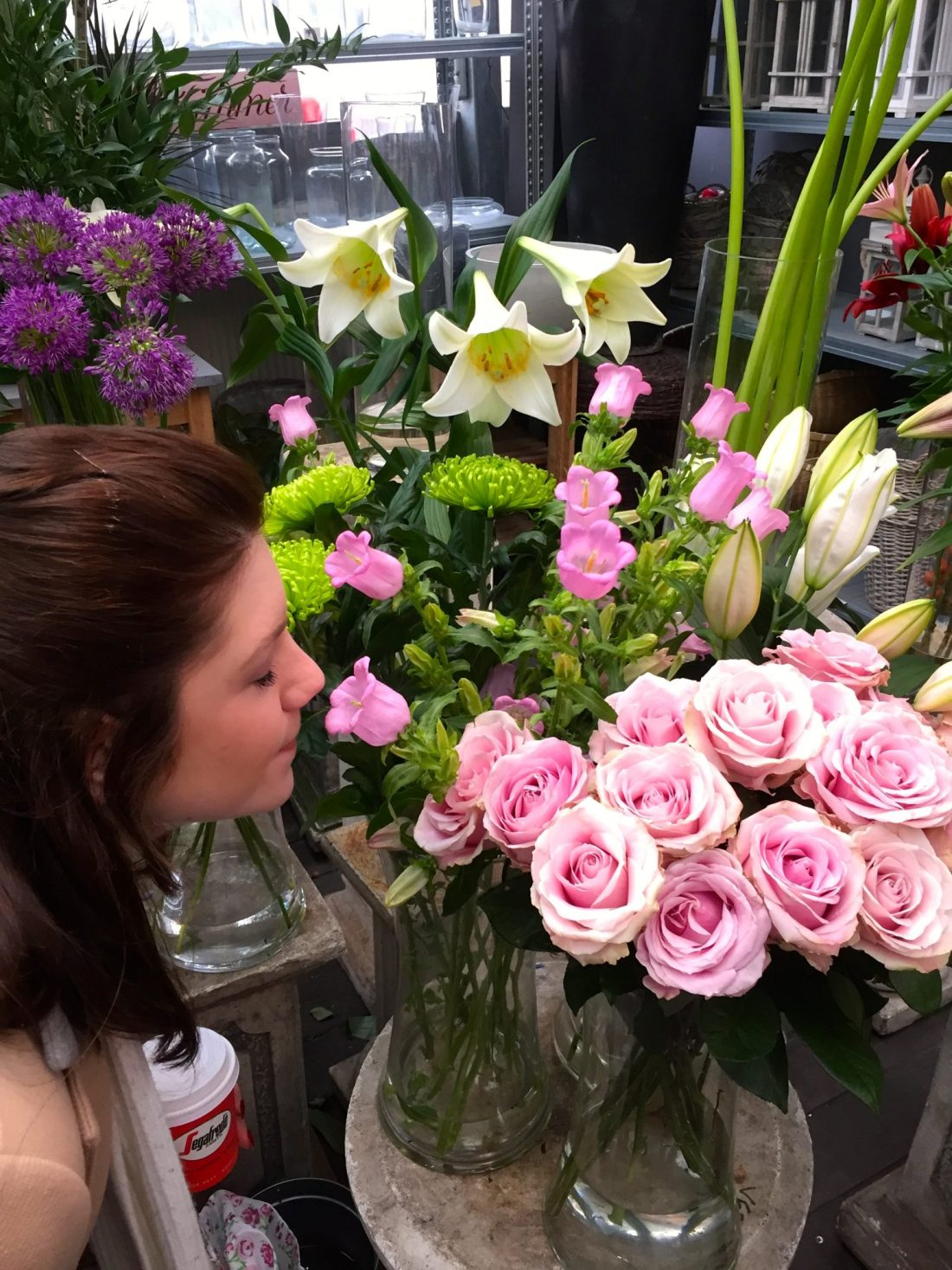 Smelling the flowers in Bloemenmarkt, Amsterdam