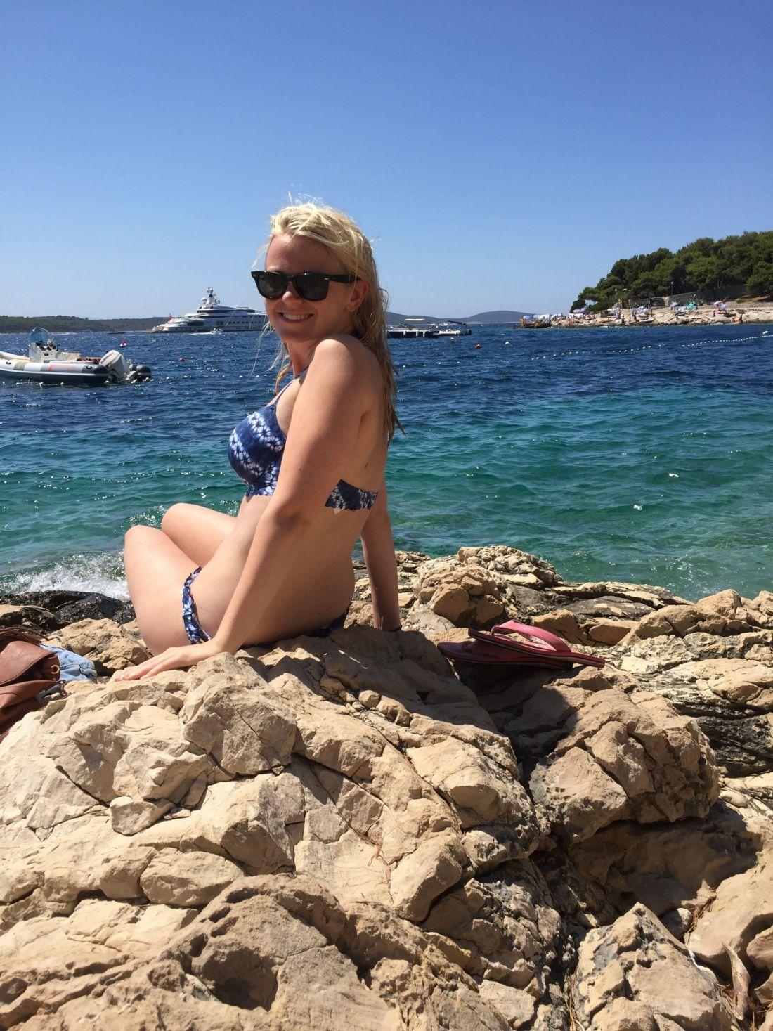 Sunbathing next to the Adriatic Sea, Croatia
