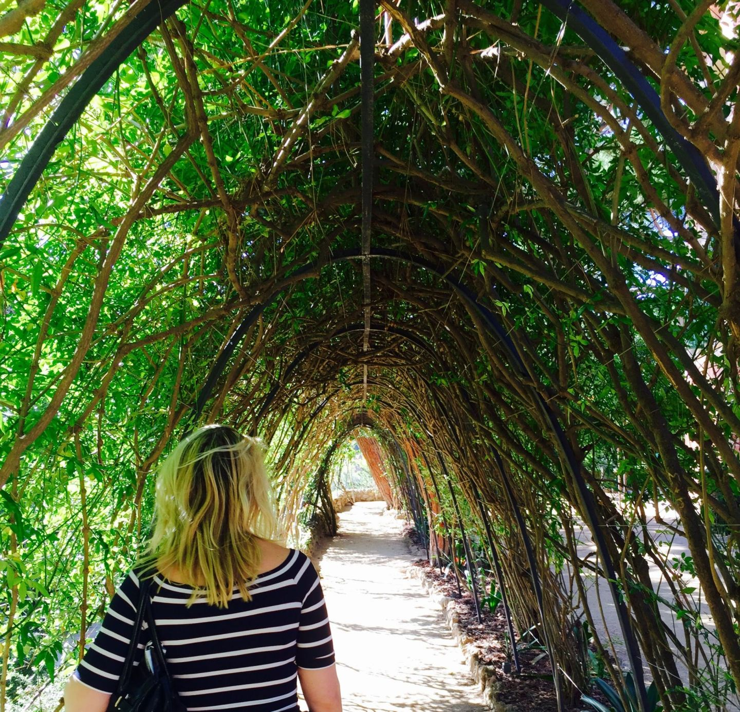 Laura in the gardens of the Gaudi House, Parc Guell