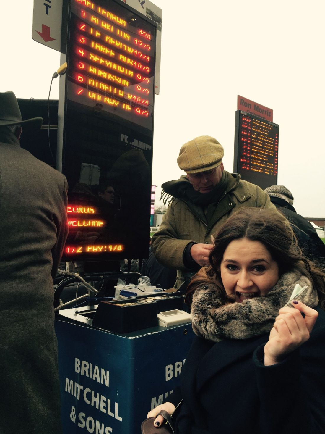 Placing bets at on New Year's Day at Cheltenham Races