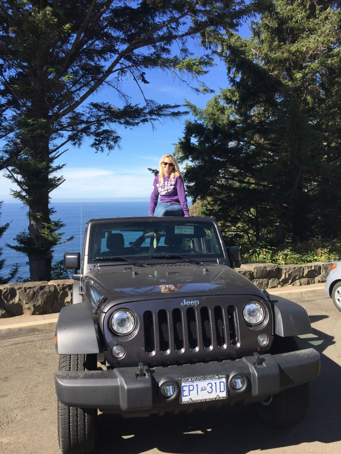 Laura in a Jeep on the Oregon Coast