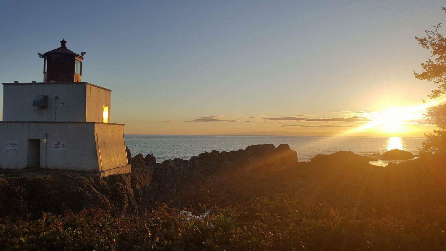 Sunset over the lighthouse at the Wild Pacific Trail