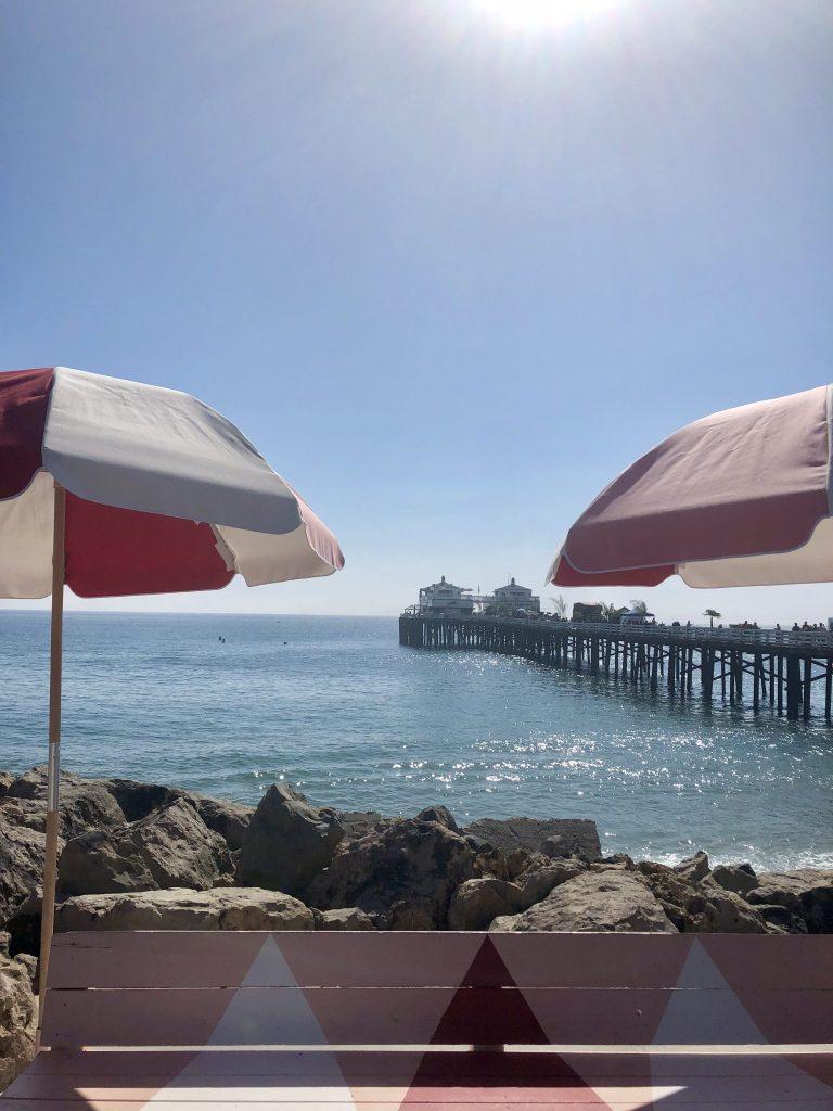 Colourful parasols overlooking Malibu Pier, California