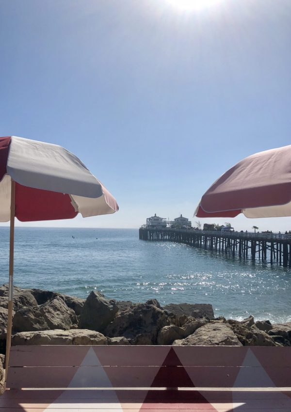 Colourful parasols overlooking Malibu Pier, California