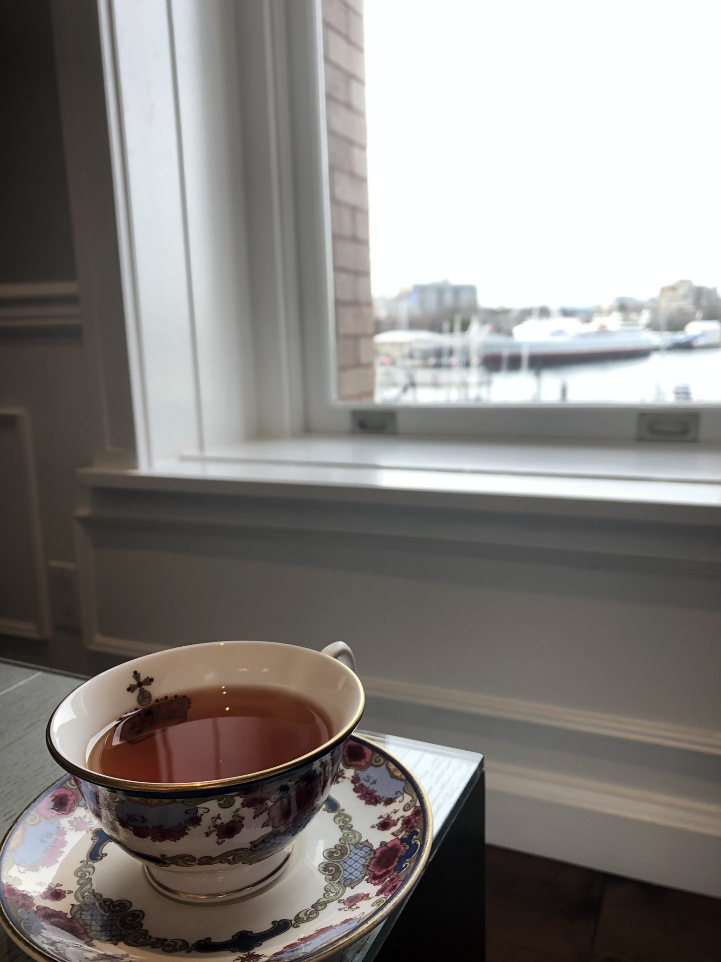 A cup of tea in the Fairmont Empress Gold Lounge, overlooking Victoria Harbour