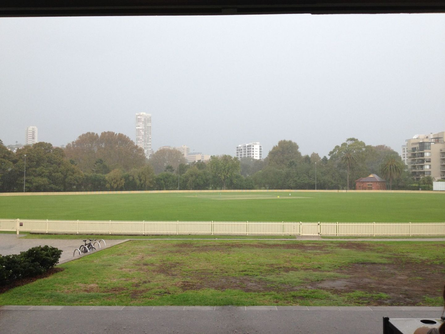 Watching the rain from a cricket pavilion in Rushcutters Bay, Sydney