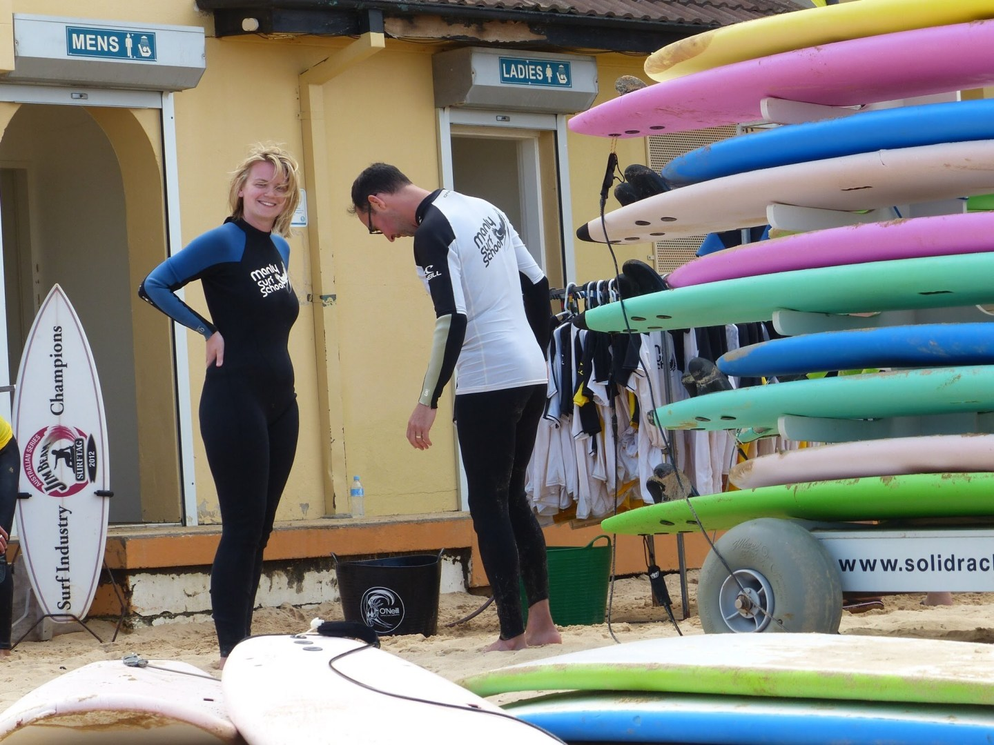 Wetsuits and surfboards at Manly Surf School, Sydney